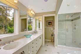 spacious all white bathroom. Spacious Bright Bathroom With White Storage Combination And Glass Door Shower Stock Photo - 31851630 All R