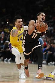 James' caps busy weekend with 32 as Lakers beat Hawks 101-96