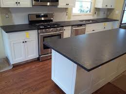 dark black modern leathered granite kitchen countertops with white cabinets 1024x768 leathered granite pros and