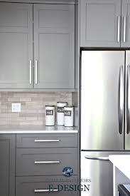 gray painted kitchen cabinets benjamin moore amherst gray quartz white countertops limestone backsplash