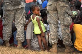 child ier essay when n child iers grow up isis child iers used  u s department of defense photo essay a little girl peers through the legs of u s army