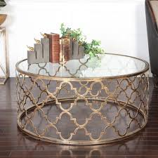 round brass coffee table with glass top