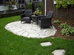 outdoor flooring over grass with ideas two black rattan chairs and small table round stone patio near green yard also footpath