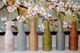 DIY Yarn Wrapped Wine Bottle Centerpiece. 18 diy yarn wrapped craft