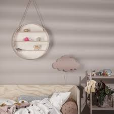 round wooden shelf hanging by cord on a nursery wall