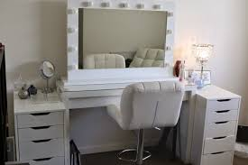 white ikea makeup vanity set with lighting and leather chair