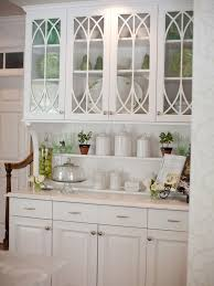 white cabinet doors with glass. this built-in hutch with traditional glass cabinet doors, beadboard backsplash and under- white doors e