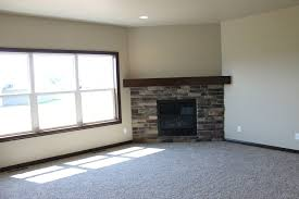 admirable corner fireplace design ideas with stacked stone and