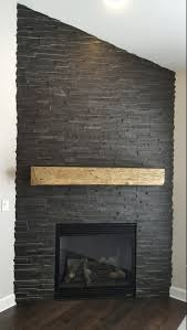 reclaimed wood mantel with stone fireplace