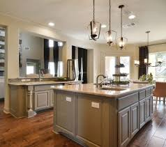 ... Burrows Cabinets kitchen island with Monaco posts and center island  with integrated corners