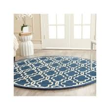 safa handmade moroccan cambridge navy ivory area rug is a handmade rugs that is made from wool blend mainly use for indoor the rugs is circle in shape