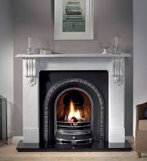 living room fireplace cast iron insert and white marble