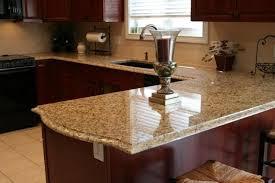 image of new venetian gold granite kitchen countertops cherry cabinets