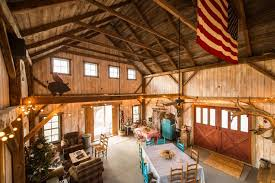 This barn has been given more contemporary look by wall finish in warm  shade of blue and by adding modern furniture.
