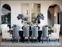 dining room set with wingback dining chair and arched doorways