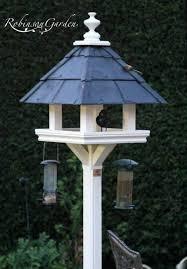 bespoke wooden bird tables farrow and