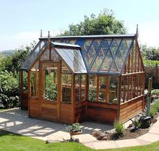 Building A Greenhouse Can Be Inexpensive If You Use Recycled Doors Buy A Greenhouse For Backyard