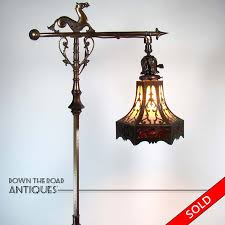rembrandt electric floor lamp with sea horse and lizard design and pierced arts crafts style