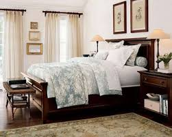 brown wall combine stone fireplace white painted dressing table blue pattern quilt beige laminated floor black black painted furniture ideas