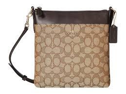 COACH. Women s Natural Signature North south Swingpack (light khaki brown) Cross  Body Handbags