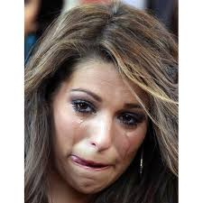 Miss France 2011 Laury Thilleman reacts after listening to the story of Alianca Misericordia, a non-profit catholic organization that rescues children from ... - cry-universe_1986321i