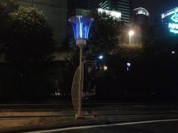 powered by solar and wind energy smart streetlights at a university in malaysia can kill mosquitoes charge mobile phones send out flood warnings and are