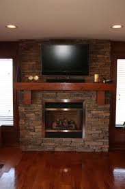 solid and interesting stone fire place design inspiration sophisticated mounted wall tv feats with wooden floating shelf and cool modern stone fireplace