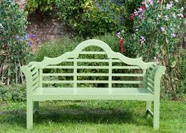 flourishing garden. We Admire How The Soothing Green Of This Bench Blends Subtlety Amongst A Flourishing Garden. Garden