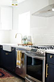 brass hardware charcoal cabinets brittanymakes