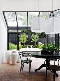 Bentwood Dining Table Atrium Sunroom Overlooking Garden Black Window Frames Black