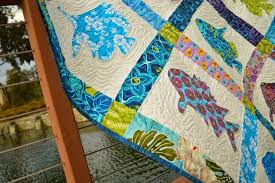 Ella's Fish Quilt & I had my quilt professionally quilted. I love how each fish is outlined by  squiggles – it looks like real water! This is my favorite quilt and I sleep  with ... Adamdwight.com