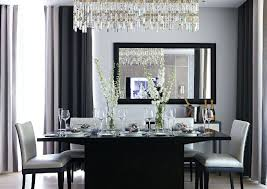 amazing dining room crystal chandelier over elegant table with stained wooden chairs lighting above height