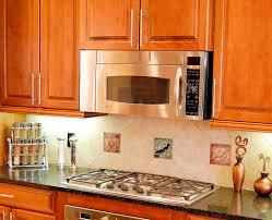coastal kitchen backsplash with decorative tile inserts