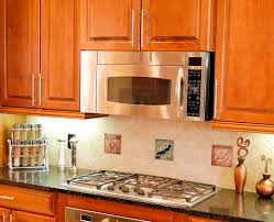 coastal kitchen backsplash with decorative tile inserts