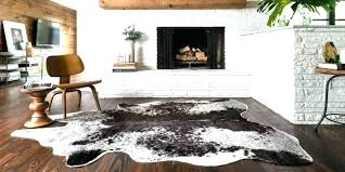 animal hide rugs for cowhide endearing home and interior design minimalist cow faux animal hide rugs black rug faux friendly in with white
