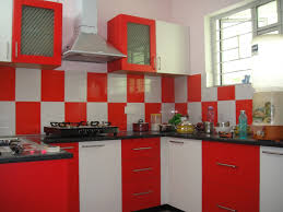 Kitchen. red and white wooden kitchen cabinet and stainless hood added by white  and red
