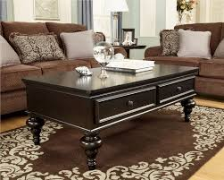 breathtaking rectangular cocktail coffee table design ideas with two drawer on brown fur rug plus brown fabric sofa