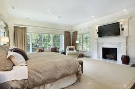 Master Bedroom Fireplace Master Bedroom In Luxury Home With Marble Fireplace Stock Photo