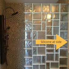use silicone or grout caulk at the side of a glass block shower wall