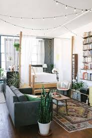 Lights For Apartment Bedroom 28 Ways To Use Those Magical String Lights Apartment Therapy