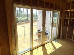 laminate floor with double glass french doors and window side for entry doors