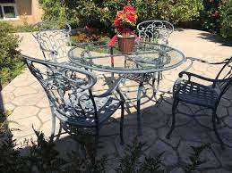 ethan allen aluminum outdoor patio furniture set with vine motif 4 chairs and round gl top