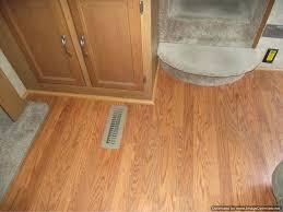 laminate flooring under kitchen cabinets installing laminate flooring around kitchen cabinets designs laminate flooring around kitchen