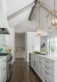 Vaulted ceiling wood beams Dark Beautiful Kitchen Boasts Gray Vaulted Ceiling Adorned With Gray Wood Beams And Pair Of Antique Brass Lanterns Darlana Light Lanterns Illuminating Faux Wood Beams 76 Best Vaulted Wood Beam Ceilings Images In 2019 Wood Beam