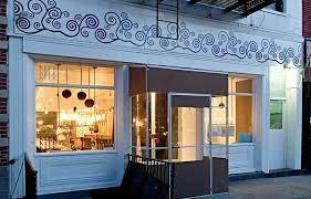 restaurant exterior wall art decoration of klee brasserie manhattan nyc