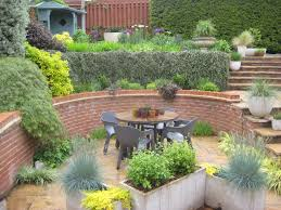 garden design using sleepers. photo 3 shows more recent work using sleepers as retainers and 4 it with mature planting hard slopes but lots of drama that garden design