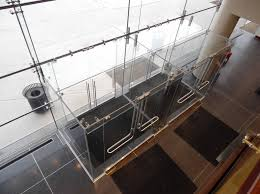 by using a glass roof canopy cantilevered sidelite walls and custom hardware we can create all glass vestibules that are virtually transpa
