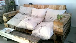 People have done some very creative things with wooden shipping pallets.  All you really need to add are cushions for a sofa.