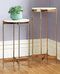 View in gallery Rose gold pedestal tables from CB2