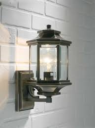ladbroke 1x100w antique brass outdoor wall lantern fitting with bevelled glass dar lighting